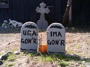 Humorous tombstones in front of a house in nor...